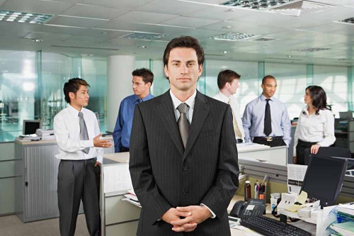 Businessman and office workers